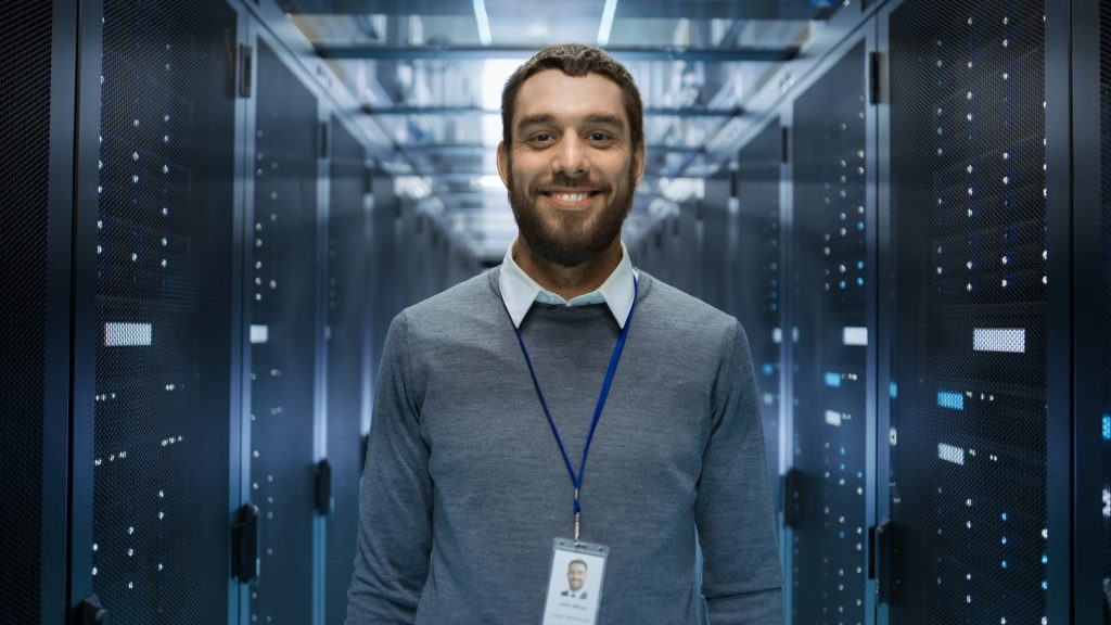 IT Specialist smiling after the easy setup of Sangoma SmartOffice.